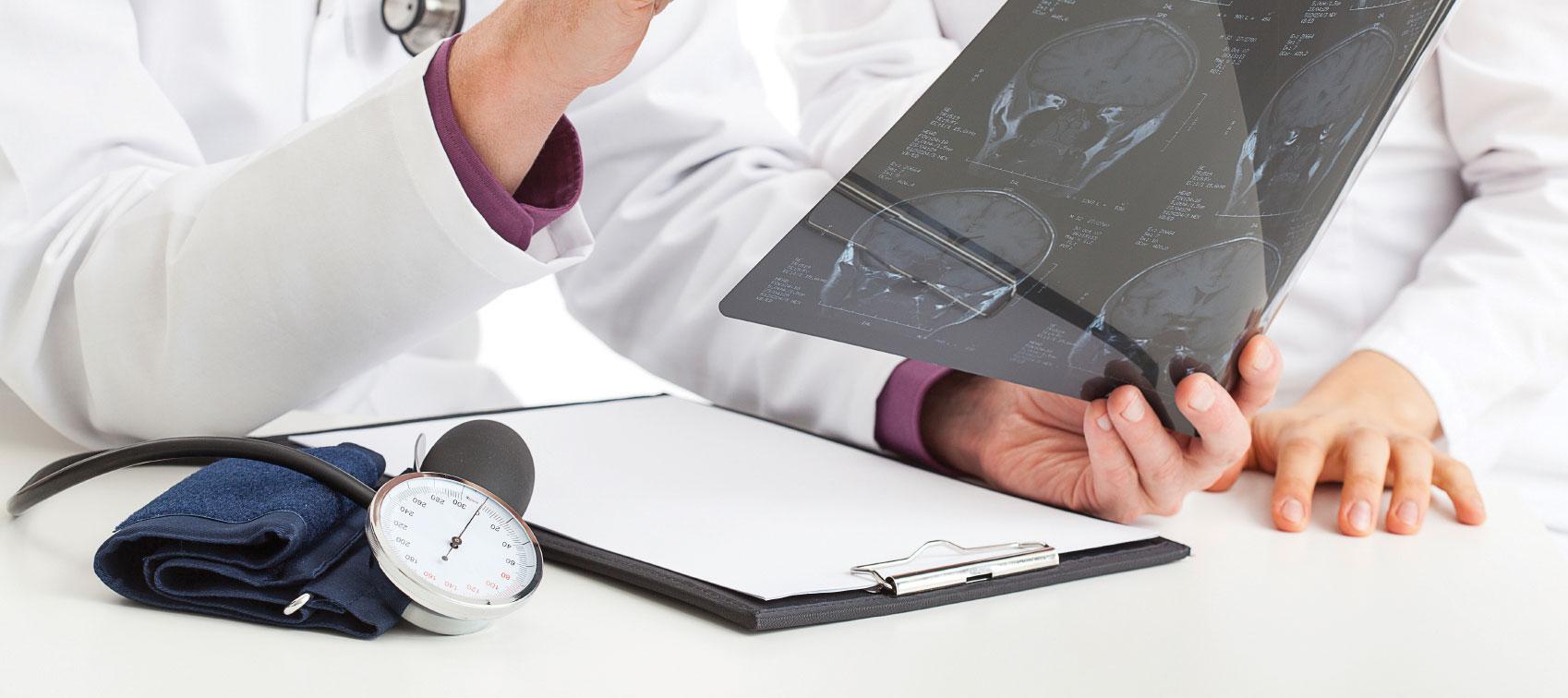 Physicians examining and X-Ray